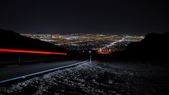 lake mead to las vegas (pbo31) Tags: city longexposure black color skyline night dark lowlight nikon cityscape lasvegas nevada over may motionblur 2012 roadway traffictrails lightstream northeastlasvegas d700 lakemeadroad