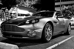 Aston Martin (Ercrawley) Tags: city longexposure portrait water car night boats photography shadows ships streetphotography ci astonmartin norfolkvirginia blackandwhiteportrait blackandwhitephotograph nighsky norfolkcity
