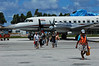 TUV-Funafuti-0609-36-v1 (anthonyasael) Tags: road shadow sky people cloud white tree horizontal plane airplane island airport exterior aircraft capital transport pacificocean staff transportation airline worker sideview runway employee pacificisland oceania tuv tuvalu funafuti