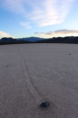 Stone race on dry lake in sunset (daveynin) Tags: sunset sky stone racetrack rocks track path playa clear wilderness drylakebed slidingstones