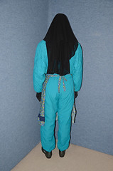 Snow Suit and Apron (Buses,Trains and Fetish) Tags: winter girl warm hijab apron suit torture sweat waitress niqab maid slave burka chador