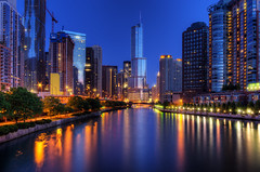 Trolling (Brian Koprowski) Tags: city longexposure morning blue chicago reflection skyline architecture downtown pentax spire bluehour wrigley chicagoriver trump hdr tribune steady aquabuilding pentaxk5 briankoprowski bkoprowski