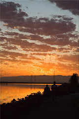 Sharing a Sunrise (Jill Clardy) Tags: city sunrise bay harbor holding hands san francisco day power cloudy silhouettes 100views redwood pylons slough westpoint equinox 6173