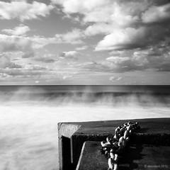 Collaroy waves (Monochrome Visions) Tags: longexposure sky seascape clouds square concrete flow blackwhite movement waves horizon sydney australia structure chain collaroy dexodexo douwedijkstra