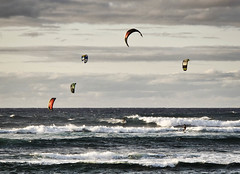 Kitesurfing (CNorthExplores) Tags: ocean canon hawaii waves afternoon pacific cloudy oahu kitesurfing g11 mokuleia explored
