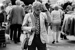 Now what did she want ?    (Street series) (Stickyemu) Tags: portrait blackandwhite bw male sunglasses bag candid streetphotography nikon1755mm28dx stphotographia lightroom5 nikond7100