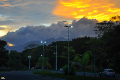 Urban lights (Otaclio Rodrigues) Tags: city trees cidade sky urban mountain cars clouds postes avenida streetlamps cu prdosol carros nuvens luzes posts avenue montanha rvores oro resende