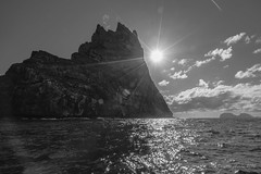 Ball's Pyramid b&w (NettyA) Tags: ocean sea sun water rock clouds australia nsw sunburst geology day7 volcanic unescoworldheritage basalt seastack lordhoweisland 2016 lhi ballspyramid basalticlava janetteasche lordhoweforclimate