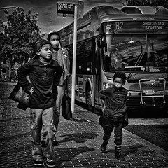 """I'm Walking Like My Big Brother"", Martin Luther King, Jr. Avenue, Historic Anacostia, Washington, DC (Gerald L. Campbell) Tags: street urban bw youth digital washingtondc blackwhite dc citylife streetphotography squareformat spirituality socialdocumentary urbanphotography historicanacostia canonsx50hs"