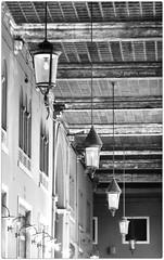 . (zioWoody) Tags: blackandwhite bw white black lamp bn luci lamps piazza vicolo bianco nero lampioni galleria biancoenero lampada treviso lampadario piazzadeisignori signori lampade lampadari podest vicolopodest