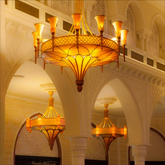 Lights of the Souk (kate willmer) Tags: building yellow architecture lights dubai arches chandelier souk dubaimall