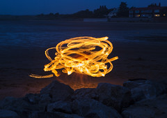 Dancing With Fire (David Chennell - DavidC.Photography) Tags: longexposure night fire timeexposure bluehour wirral westkirby merseyside