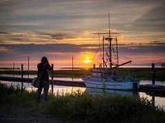 The Photographer (iPhilFlash) Tags: fraserriver sunset water scotchpond fishingboat photographer clouds travel britishcolumbia cloud slough richmond canada sky silhouette garrypointpark steveston ca