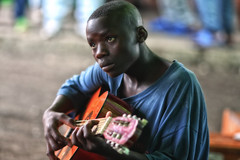 hope in music (~mimo~) Tags: africa travel portrait music look soldier photography hope war child guitar places conflict congo drc democraticrepublicofcongo mimokhair