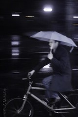 Rain Cyclin' (RTsan) Tags: usa monochrome rain bicycle night umbrella canon connecticut infrared newhaven rider eos350d falsecolorinfrared ef35mmf20 camcmullenphotography
