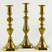 184. 19th Century Brass Push Up Candlesticks
