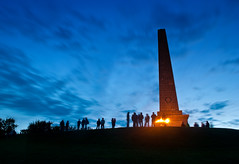 Gathering (Alistair Hamill) Tags: blue ireland sky monument fire elizabeth jubilee queen flame northern beacon newtownabbey knockagh diamondjubliee