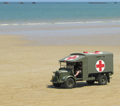 Remembering D - Day (Sandy Leidholdt) Tags: old france beach truck french coast seaside frankreich europa europe european wwii frana historic ambulance medical worldwarii beaches vehicle trucks tribute normandie frankrijk cote medic normandy francia dday englishchannel symbolic frankrig redcross barricades camin omahabeach medics plages landings bassenormandie disembarkment vehculo normandycoast sandraleidholdt lowernormandy plagesdudebarquement alliedinvasion leidholdt a5417382 drp322