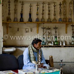man smoking water pipe (setboun photos) Tags: africa food architecture cafe smoke egypt smoking pharaoh antiques fumeur smoker luxor egypte chicha afrique narguile pharaonic foodanddrinks fumee pharaon egyptians louxor antiquite antiquites nilevalley northafricans egyptien louqsor africanethnicity egyptianculture egyptiens arabcountry smokingwaterpipe paysarabe egyptianethnicity pipeaeau caferestaurantandbar repasetboisson cultureegyptienne culturepharaonique pharaonicculture nordafricains valleedunil