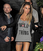 Katie Price aka Jordan arriving back at her hotel following a night out with boyfriend Leandro Penna. Katie almost fell into a plant pot, as she made her way into the hotel, and had to steady herself. London, England