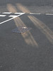 light & road (the incredible how (intermitten.t)) Tags: road light shadow tarmac asphalt reflectedlight 16154 10102010