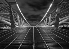Pedestrian Bridge in B+W (w4nd3rl0st (InspiredinDesMoines)) Tags: longexposure bridge urban blackandwhite bw tourism weather metal night vancouver digital canon photography lights design yahoo spring cloudy outdoor steel pedestrian urbanexploration walkway trendy falsecreek 5d condos olympicvillage vanguard 2012 2010 urbex 1740l winterolympics getlow placestosee niksilverefx projectweather sbh300 altapro athletesway 263at