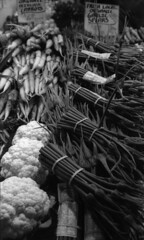 (rossbysmom) Tags: seattle blackandwhite bw film vegetables trix 400 cauliflower carrots pikeplacemarket nikonn80 marketstall garlicspears