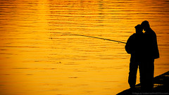 Fishing (AgusValenz) Tags: sunset people orange yellow backlight contraluz nikon coolpix kazakhstan ural atyrau p80 kazajistan