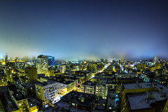 Foggy City Lights (tobyharriman) Tags: pictures sf sanfrancisco california longexposure light color northerncalifornia fog night canon buildings cityscape cloudy foggy scenic blues fisheye 7d bayarea nik colorefexpro tobyharriman