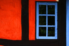 Let the Fairytale Begin (Ladybird Photography) Tags: wood old blue red house black detail reflection window glass museum fairytale rural denmark colours open outdoor blu air colourful rd rosso danmark colori sort nero bl lyngby tricolore udendrs frilandsmuseet farver farverig