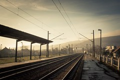 Romance on Rails (Gilderic Photography) Tags: voyage city trip morning travel winter light people cinema lines station electric train canon bench way walking landscape eos couple europe raw cityscape gare path widescreen hiver wide perspective large rail romance lovers slovensko slovakia cinematic quai bratislava chemin banc voie fils lightroom 500d electrique gilderic slovakie