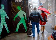 Apeing (John Fraissinet) Tags: street nyc newyorkcity red woman ny newyork man paris rain wall umbrella sony coat streetphotography ampelmann nex7