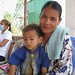 Mother and child visit a mobile clinic in Udong, Cambodia