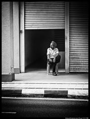 Guarding to Deceive (aizuddindanian) Tags: street bw empty guard olympus security doorway kuala sikh 45mm lumpur omd f40 premise aizuddin em5 123bw danian