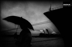 LON38337_Social_Media_Watermark (shellatorg) Tags: shadow blackandwhite white black silhouette night port umbrella sadness grey day ship exterior sydney scenic australia ombre pacificocean newsouthwales whitepeople bateau extrieur nuit oneperson tristesse sydneyoperahouse pnombre parapluie australasia masculin oceania candidphotography halflight midadult travelpictures weatherclimate ocanpacifique waistup nofaces ocanie opradesydney nouvellegalledusud unrecognisable couleurgris manallages climatologie worldocean typehumainblanc globalholidays indoaustralianplate thematicpictures otherormixed