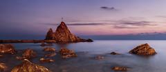 Meditating at twilight (Enrico Cusinatti) Tags: longexposure travel sunset sea italy sun mer clouds eos rocks exposure italia tramonto nuvole mare liguria cielo rocce viaggi esposizione 6d orizzonte nubi lungaesposizione enricocusinatti rivatrigono
