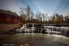 Spring at Honeoye Falls (awaketoadream) Tags: new york blue sky usa america flow waterfall spring long exposure state low falls american honeoye