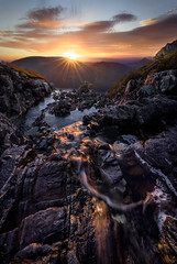 Autumn Light (hillsee) Tags: light lake mountains colour clouds sunrise waterfall australia tasmania sunstar cradlemountainnationalpark