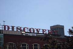 """Discovery"" (Sam DeGenova) Tags: baltimore buildings city cars sun shine reflections people street america"