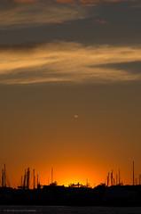 Sunset from the Hyat Regency Boston Harbor (alohadave) Tags: sunset sky water boston skyline harbor unitedstates massachusetts places northamerica eastboston partlycloudy bostonharbor hyattharborside pentaxk5 smcpda60250mmf4edifsdm hyattregencybostonharbor
