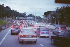 jammed~ (asuramaru™) Tags: stilllife cars film 50mm gold highway traffic minolta kodak malaysia kualalumpur analogue 2012 x700 jammed rokkor busylife mrr2 ƒ17