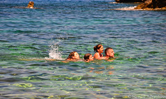 "Father Swimming with Daughters -  Lo Zingaro, Sicily • <a style=""font-size:0.8em;"" href=""http://www.flickr.com/photos/40100768@N02/7176823819/"" target=""_blank"">View on Flickr</a>"