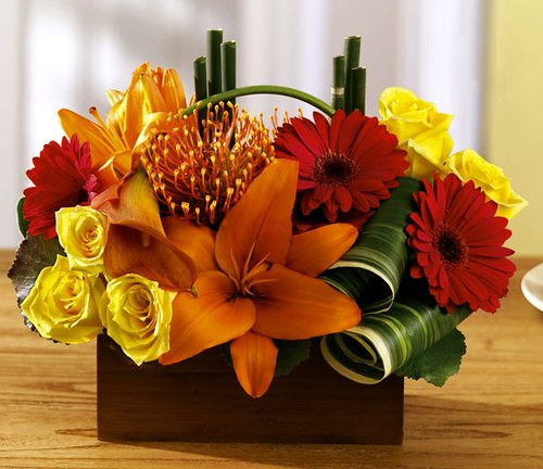Arrangement of gerberas, lilies and roses