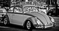 pumped volkswagen beetle (yojimboa) Tags: street blackandwhite car vancouver bokeh wheels retro englishbay pimpmyride volkswagenbeetle pentaxm50mmf20 pentaxk5