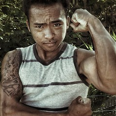 Bali - Young man near Amed (1) : inked and muscled ( j  r e n) Tags: portrait bali colour muscles tattoo square couleur youngman carr villager jeunehomme amed 500x500 indonsie villageois