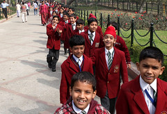 School Children at the Gandhi Memorial (cowyeow) Tags: street city travel school boy red portrait people woman india man cute boys students smile kids walking children fun happy kid student funny couple uniform little delhi indian smiles bored together gandhi sikh schooluniform rajasthan redshirt newdelhi redfort olddelhi gandhimemorial funnyindia boylittle