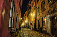 Old Town by Night X (henriksundholm.com) Tags: street door flowers houses windows night buildings sweden stockholm bikes flags bicycles cobblestone pots shops gamlastan sverige lamps stores oldtown hdr lightstar