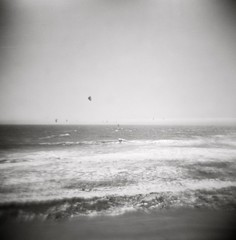 early summer is here: small wave kiting and strong wind, santa cruz, may 2012 [#023704] (Jeff Merlet Photography) Tags: ocean california sea blackandwhite bw usa santacruz kite 120 film water sport analog toy fly holga published pacific wind 04 horizon extreme toycamera wave kiteboarding kitesurfing riding 100 kiteboard rider kitesurf kiting negatif watersport 120n kitesurfer shorebreak rpl kiteboarder adox chs100 analogphotgraphy chs100art thelanetowaddell jeffmerletphotography jeffmerlet photojeffmerletcom r0237 rpl05888 023704