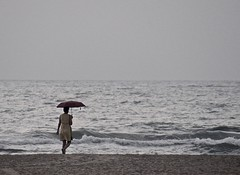 WOMAN WITH A RED UMBRELLA ON THE BEACH (Burlingamebarley) Tags: india beach indianocean earlymorning pondicherry bayofbengal puducherry womanwitharedumbrellaonthebeach