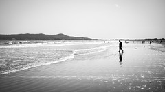 At the beach - Portmarnock, Ireland - Black and white street photography (Giuseppe Milo (www.pixael.com)) Tags: street ireland sea summer sky people urban blackandwhite bw dublin sun man beach water silhouette backlight reflections walking geotagged photography photo europe fuji candid streetphotography faceless fujifilm ie onsale portmarnock fujix xt10 fujixt10